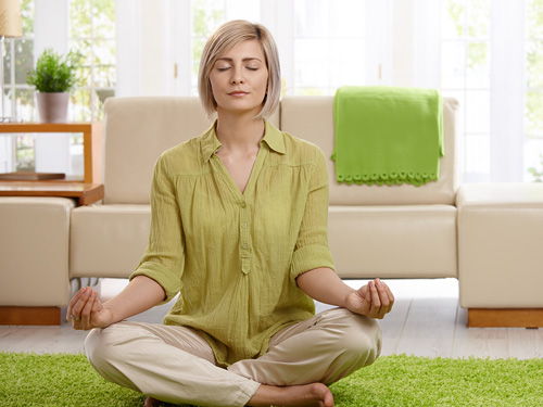 Meditation Apps for Daily Practice - woman meditating at home