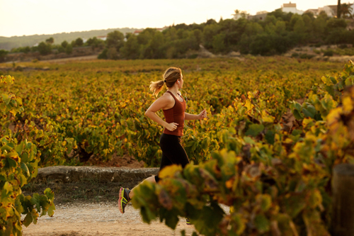 How Regular Exercise Helps Recovery - woman running in a field