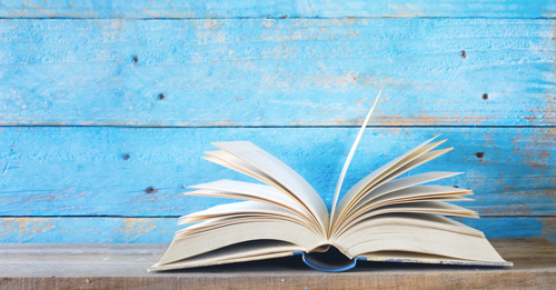 What to Expect in a 12-Step Program - open blue book against blue painted wood background