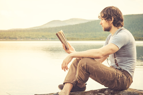 Motivational-Books-for-Healthy-Living-Building-Your-Recovery-Reading-List - man reading by lake